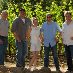 group standing in vineyard